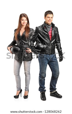 Full length portrait of two young motorcyclers in a leather jacket posing isolated on white background - stock photo