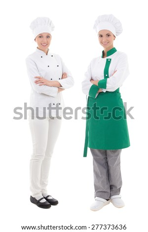 full length portrait of two young women chefs isolated on white background - stock photo