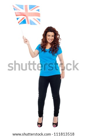 Full length portrait of UK female supporter posing with flag