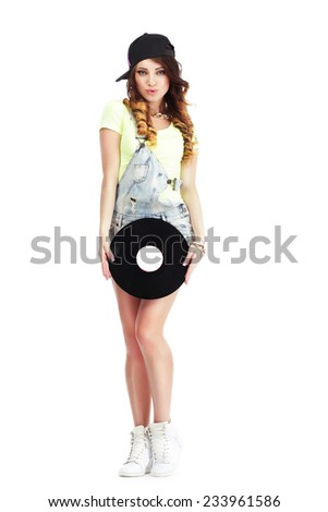 Full  Length Portrait of Woman in Kepi and Jeans with Vinyl Record - stock photo