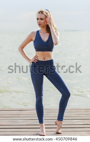 Full-length portrait of woman near the sea - stock photo