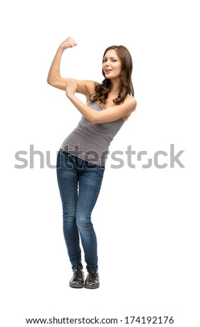Full-length portrait of woman showing bicep, isolated on white. Concept of strength and sports