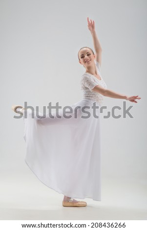 Full length portrait of young and beautiful modern style ballet dancer posing, classical ballet, isolated on white background, studio shot - stock photo