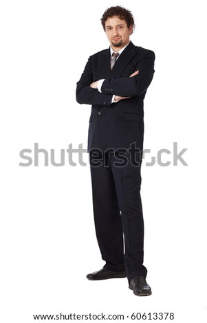 Full length Portrait of young business man with folded hands on white - stock photo