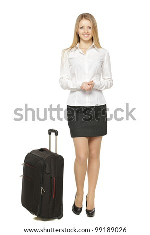 Full length portrait of young business woman standing with black travel bag isolated on white background - stock photo