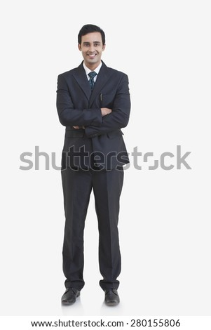 Full length portrait of young businessman isolated over gray background - stock photo