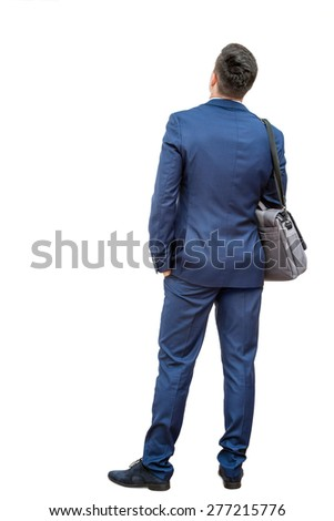 Full length portrait of young businessman standing in blue suit. Young man giving back to camera showing rear view.Isolated on white background. - stock photo