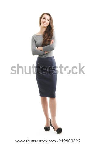 Full length portrait of young businesswoman standing against white background.