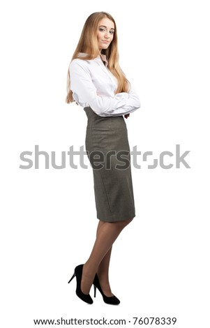 Full length portrait of young confident  businesswoman with crossed arms, isolated on white background - stock photo