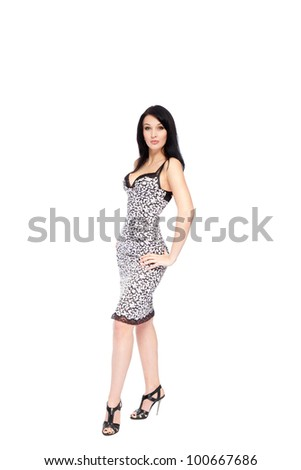 Full length portrait of young fashion woman in dress smiling, posing isolated over white background - stock photo