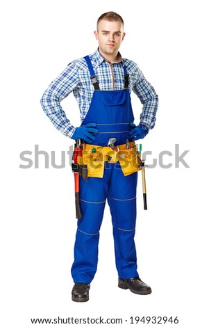 Full length portrait of young male construction worker with tool belt isolated on white background - stock photo