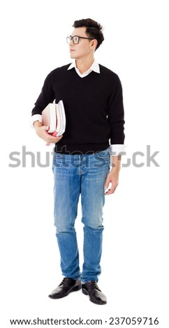 Full length portrait of  young man holding books - stock photo