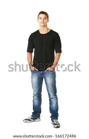 Full length portrait of young man standing with hands in pockets  isolated on white background - stock photo