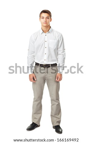 Full length portrait of young man wearing white shirt and light trousers isolated on white background