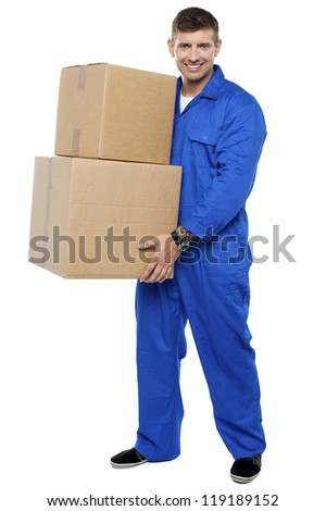 Full length portrait of young smart relocation staff carrying cartons - stock photo