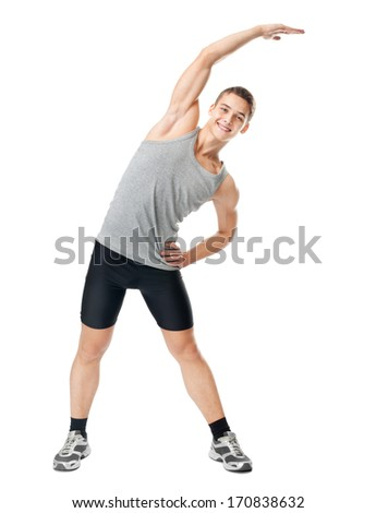 Full length portrait of young smiling man athlete doing exercises isolated on white background - stock photo