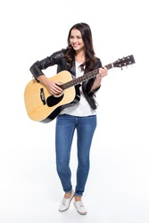 Full Length Portrait Of Young Smiling Woman Playing Guitar Isolated On White