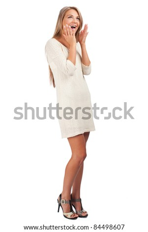 Full length portrait of young stylish woman looking surprised, against white background