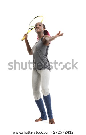 Full length portrait of young woman playing tennis on a dross field. Healthy lifestyle. Isolated white background - stock photo