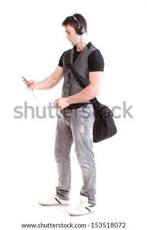 Full length portrait school boy phone headphone music isolated on white