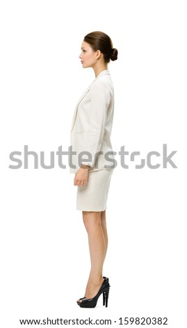Full-length profile of business woman, isolated on white. Concept of leadership and success - stock photo