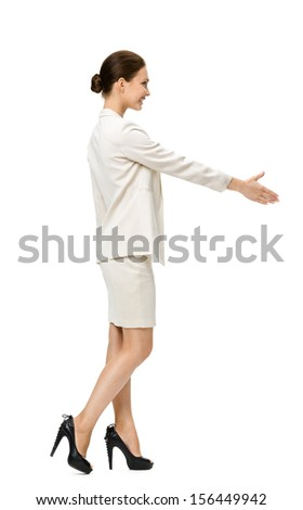 Full-length profile of businesswoman handshaking, isolated on white. Concept of leadership and success - stock photo