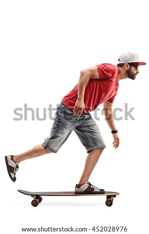 Full length profile shot of a male skater riding a longboard isolated on white background