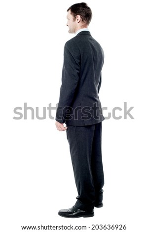 Full length rear view image of a businessman