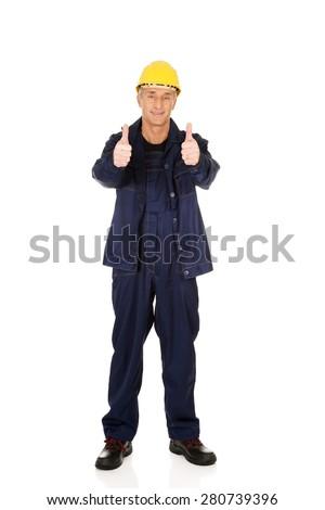 Full length repairman showing thumbs up. - stock photo