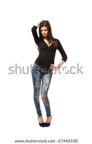 Full length shot of a beautiful hispanic woman in high heels and jeans, isolated on white background - stock photo