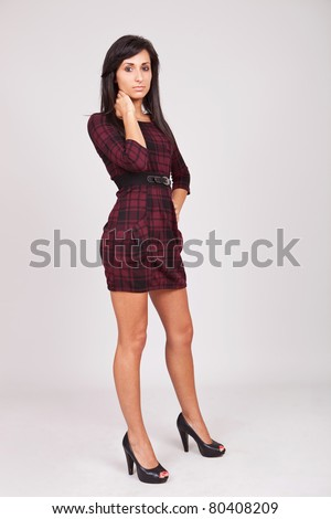 Full length shot of a beautiful woman in high heels and red dress - stock photo