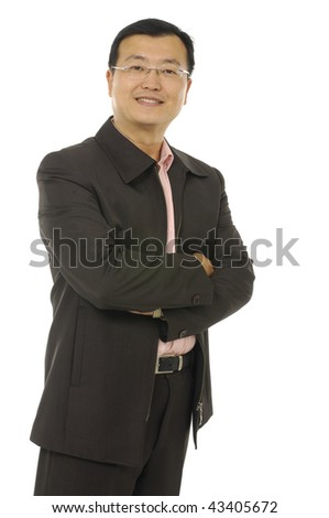 Full length shot of a mature businessman wearing a suit with his arms folded - stock photo