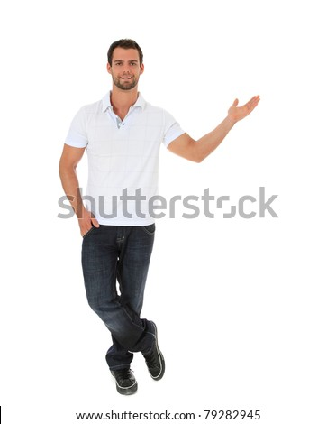 Full length shot of an attractive man pointing to the side. All on white background.