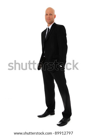 Full length shot of an attractive man wearing black suit. All on white background. - stock photo
