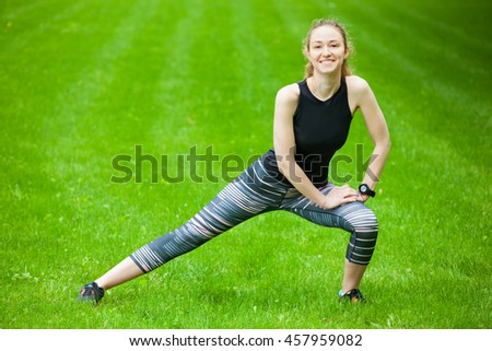 Full length shot of an attractive young woman stretching before running.