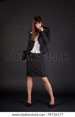 Full length shot of business woman over black background - stock photo