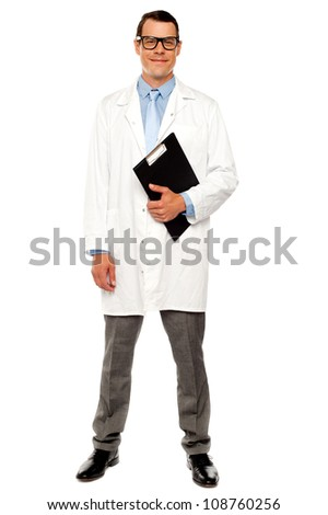 Full length shot of male doctor posing with clipboard over white - stock photo
