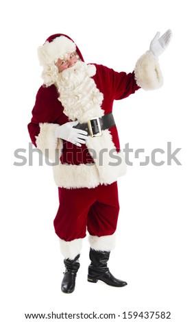Full length shot of Santa Claus gesturing - stock photo