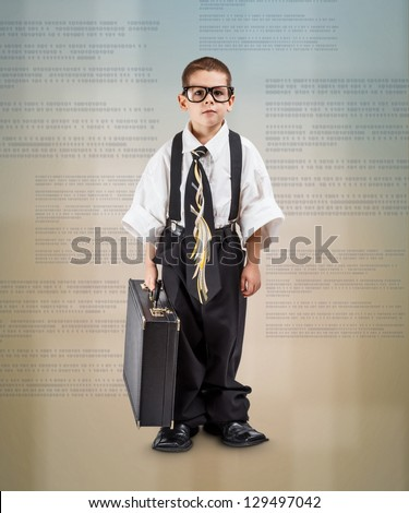 Full length shot of serious little business boy - stock photo