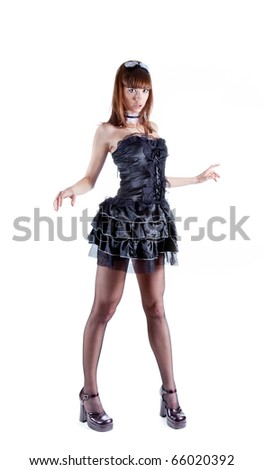 Full length shot of sexy woman dressed as French maid, isolated on white background