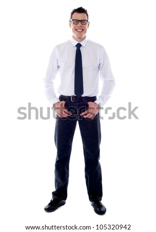 Full length shot of stylish male executive standing with hands in pocket - stock photo