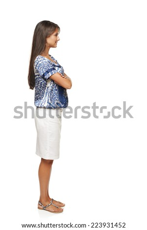 Full length side view business woman standing with folded hands and looking forward, isolated on white background - stock photo
