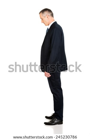 Full length side view businessman standing. - stock photo