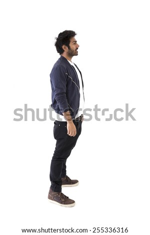 Full-length side view image of an Indian man wearing Polo t-shirt & Jeans. Isolated on White Background - stock photo