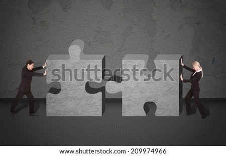 Full length side view of business people joining puzzle pieces