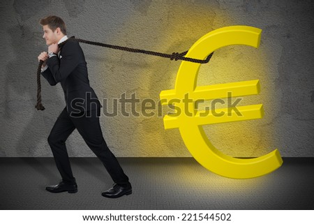 Full length side view of determined businessman pulling glowing euro sign against wall - stock photo