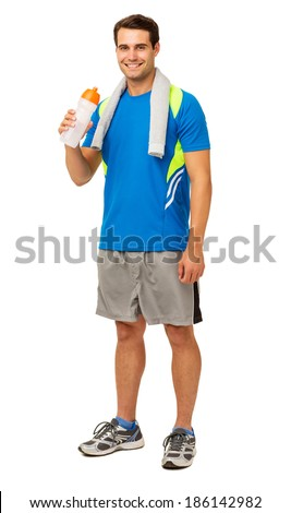 Full length side view of young man exercising with kettle bell over white background. Vertical shot. - stock photo