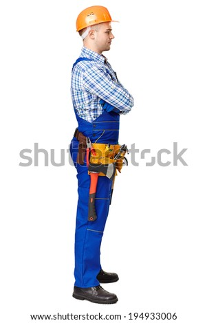 Full length side view portrait of young male construction worker wearing protective clothes, helmet and tool belt isolated on white background - stock photo