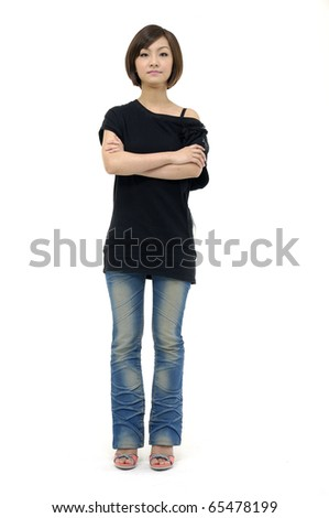 Full length smiling asian posing in studio - stock photo