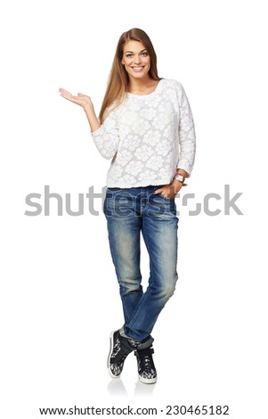 Full length smiling beautiful woman showing open hand palm with copy space for product or text, over white background - stock photo